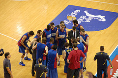 Barca, the Spanish League regular season champion, huddle-up before tip-off